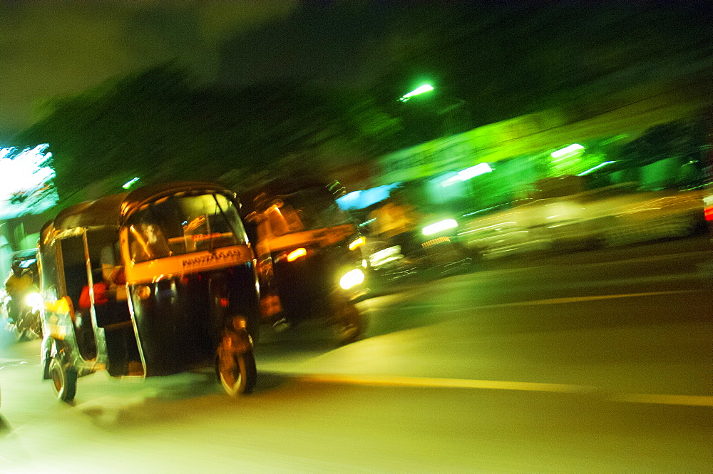Speeding tuk-tuk at night, Mumbai (Bombay), India, South Asia