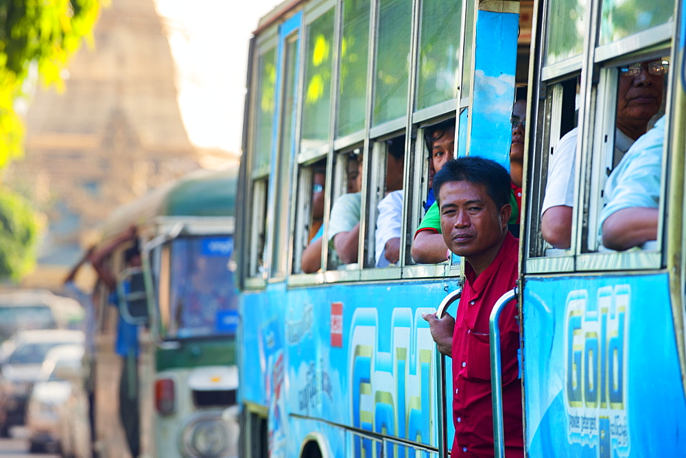 Commuters on a packed city bus, Yangon (Rangoon), Myanmar (Burma), Asia
