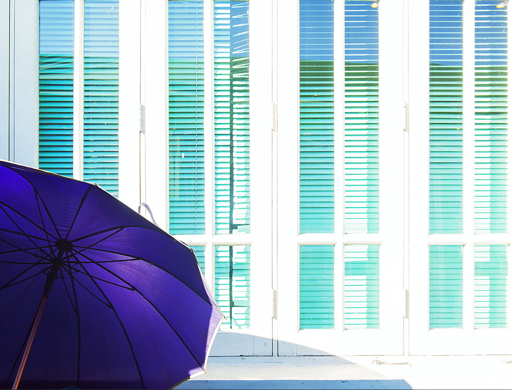 Abstract of purple parasol and cyan window shutters, Naypyitaw, Myanmar (Burma), Asia