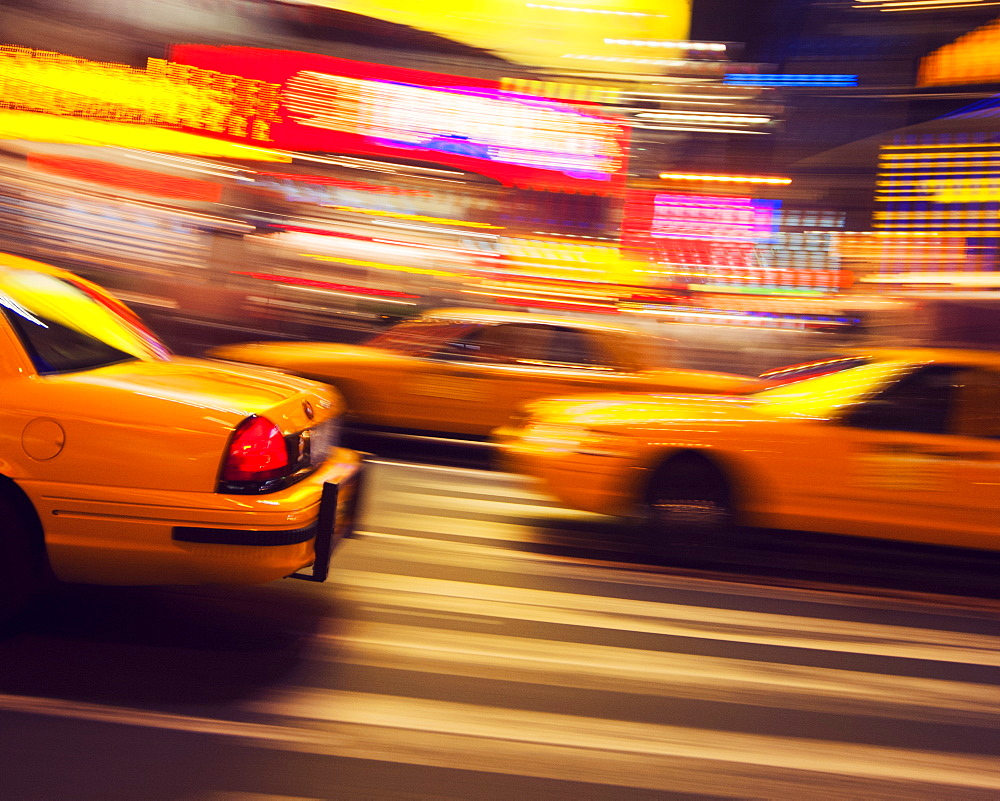 Traditional yellow taxi at night, New York City, United States of America, North America