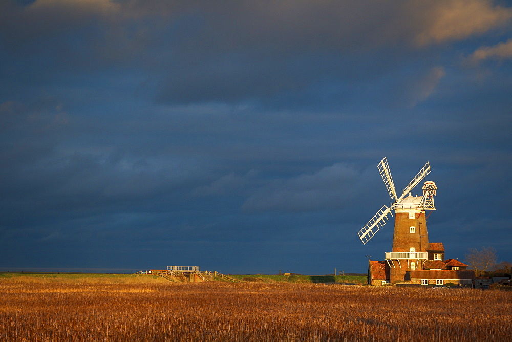 Storm clouds move in over the reedbeds towards Cley Windmill at Cley Next the Sea, Norfolk, England, United Kingdom, Europe - 1213-104