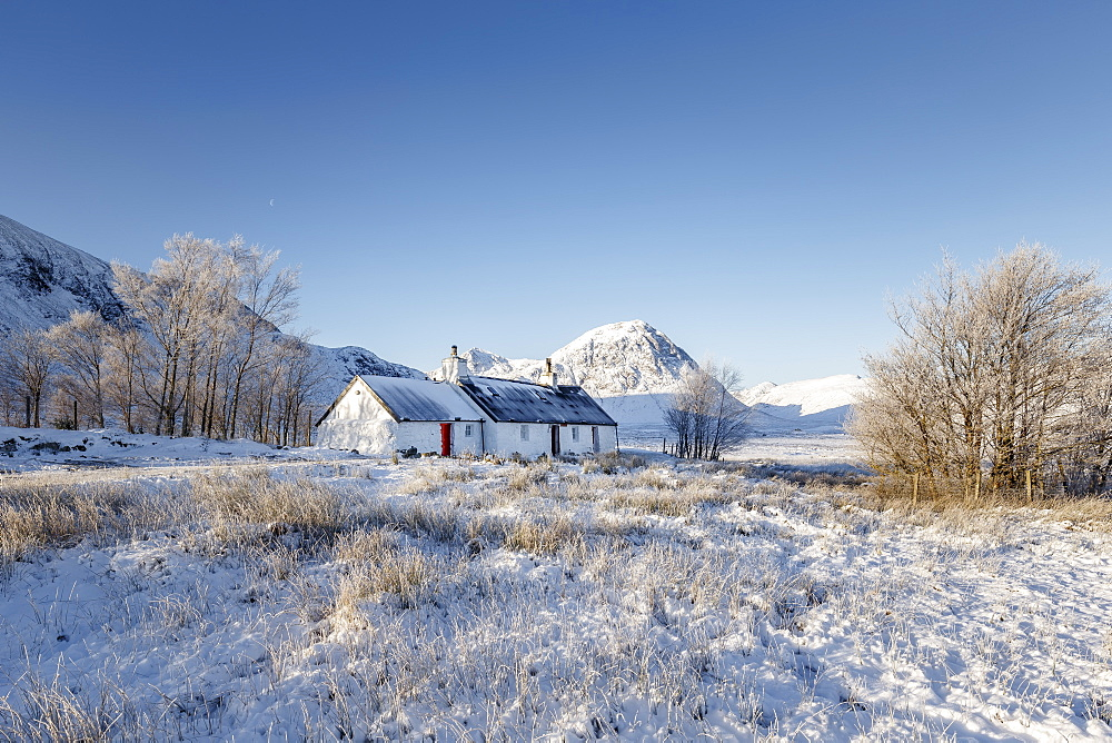 A winter scene at Black Rock cottage and Buachaille Etive Mor on Rannoch Moor, Highlands, Scotland, United Kingdom, Europe
