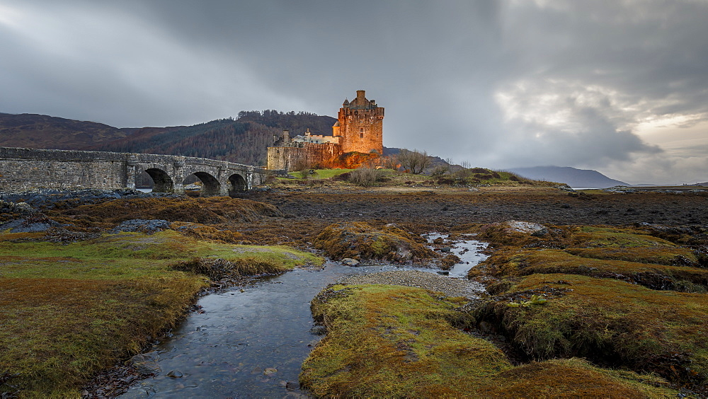 Dusk at Eilean Donan (Eilean Donnan) Castle in Dornie, Highlands, Scotland, United Kingdom, Europe