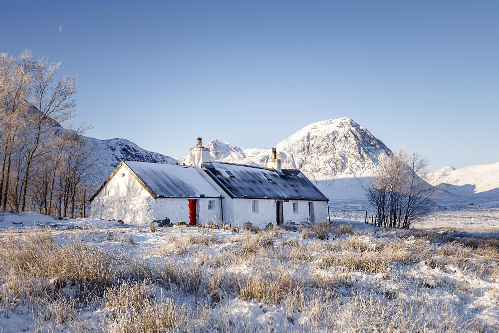 A wintery scene at Black Rock cottage and Buachaille Etive Mor on Rannoch Moor, Highlands, Scotland, United Kingdom, Europe