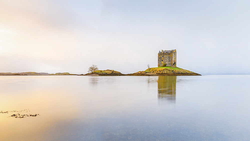 Castle Stalker on its own island in Loch Linnhe surrounded by mist, Argyll, Scottish Highlands, Scotland, United Kingdom, Europe