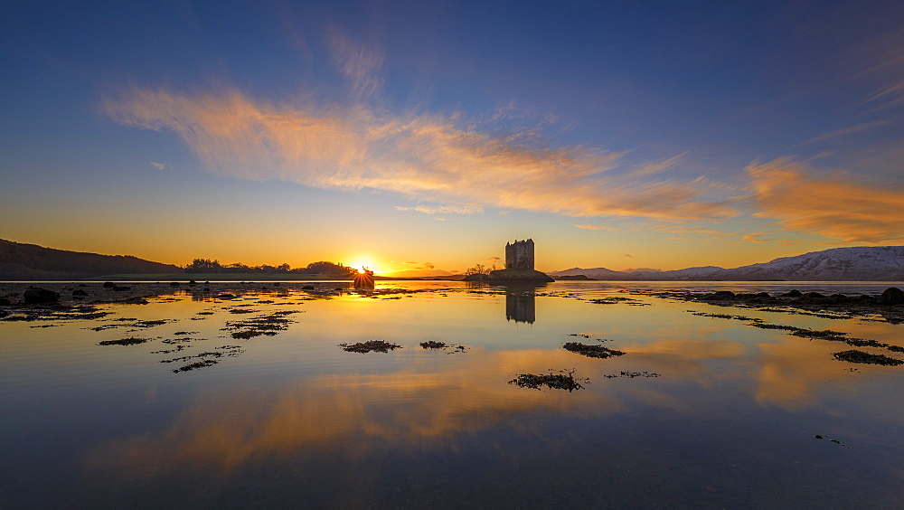 Sunset at Castle Stalker, a keep on its own island in Loch Linnhe, Argyll, Scottish Highlands, Scotland, United Kingdom, Europe.