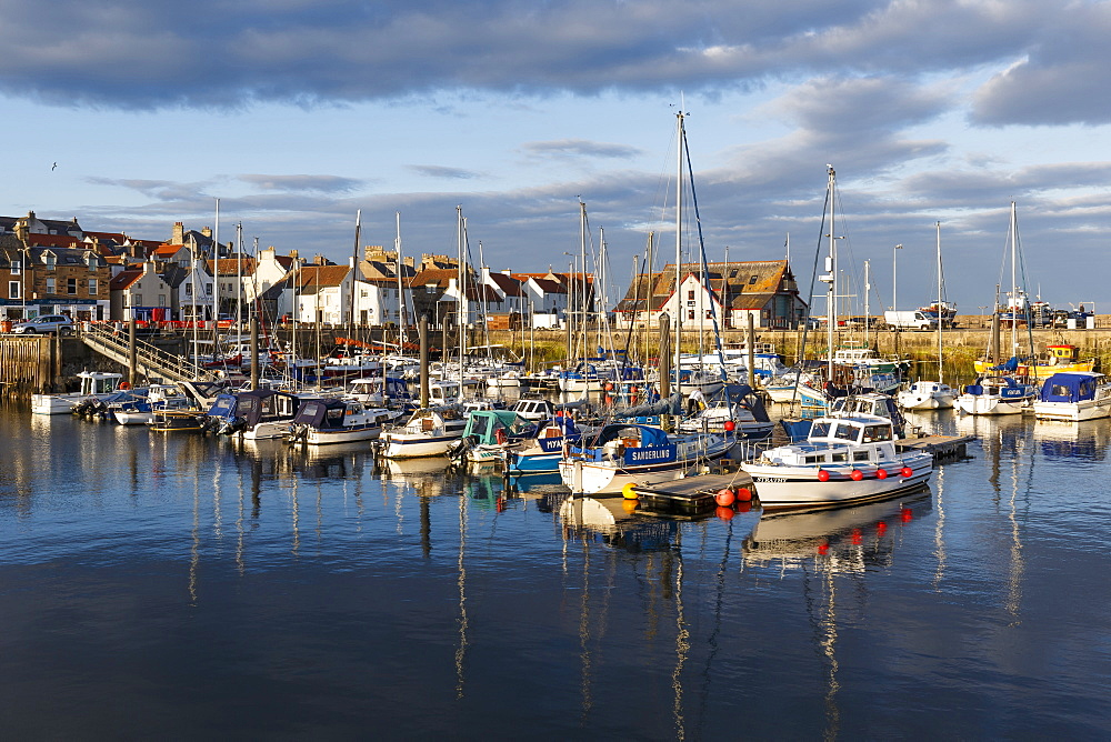 Sailing boats at sunset in the harbour at Anstruther, Fife, East Neuk, Scotland, United Kingdom, Europe