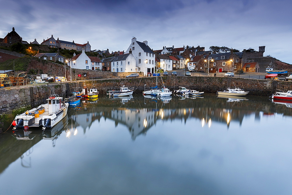 Fishing boats in the harbour at Crail at dusk, East Neuk, Fife, Scotland, United Kingdom, Europe