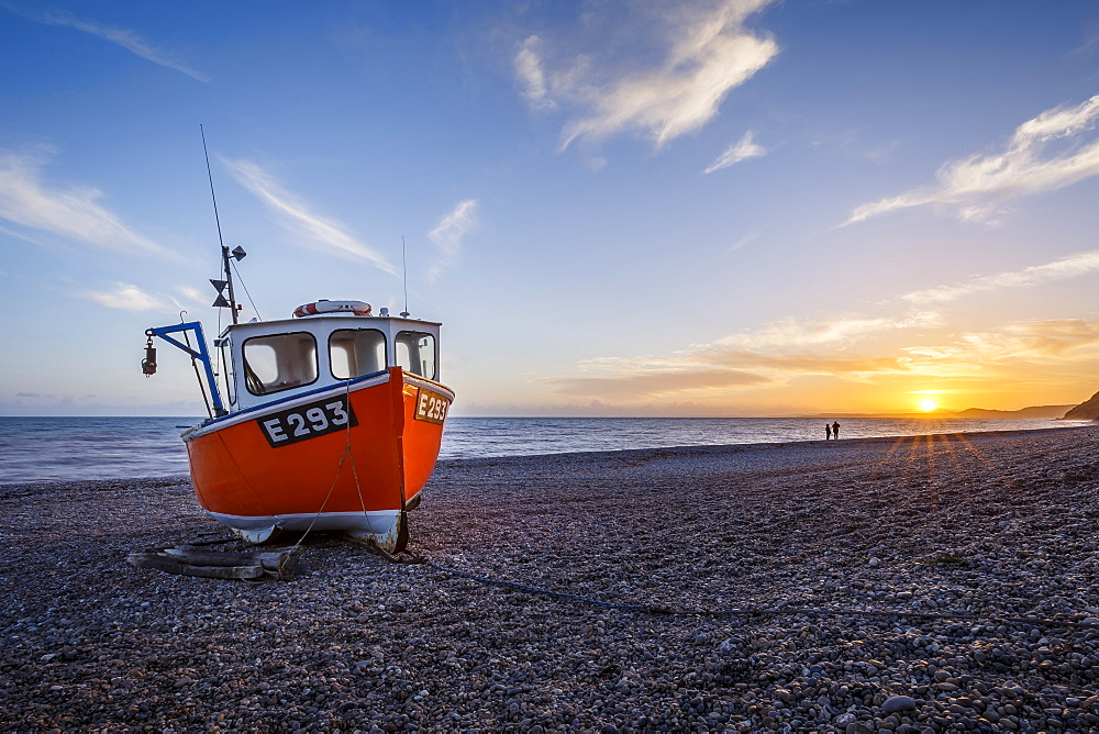 Fishing boat moored on Branscombe Beach at sunset, Seaton, East Devon, England, United Kingdom, Europe