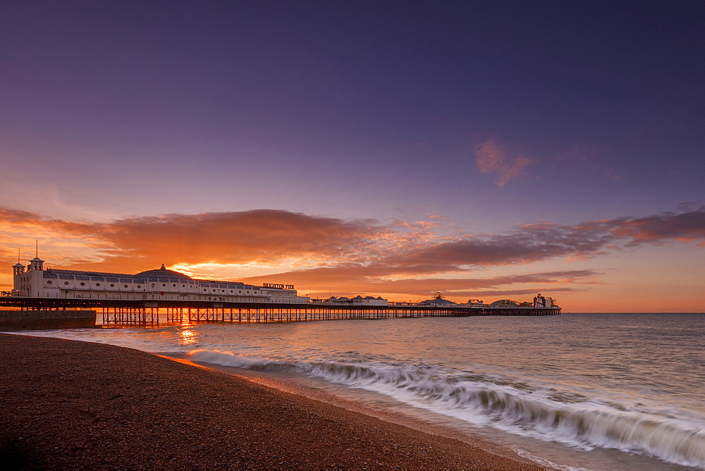 Brighton Pier and beach at sunrise, Brighton, East Sussex, Sussex, England, United Kingdom, Europe