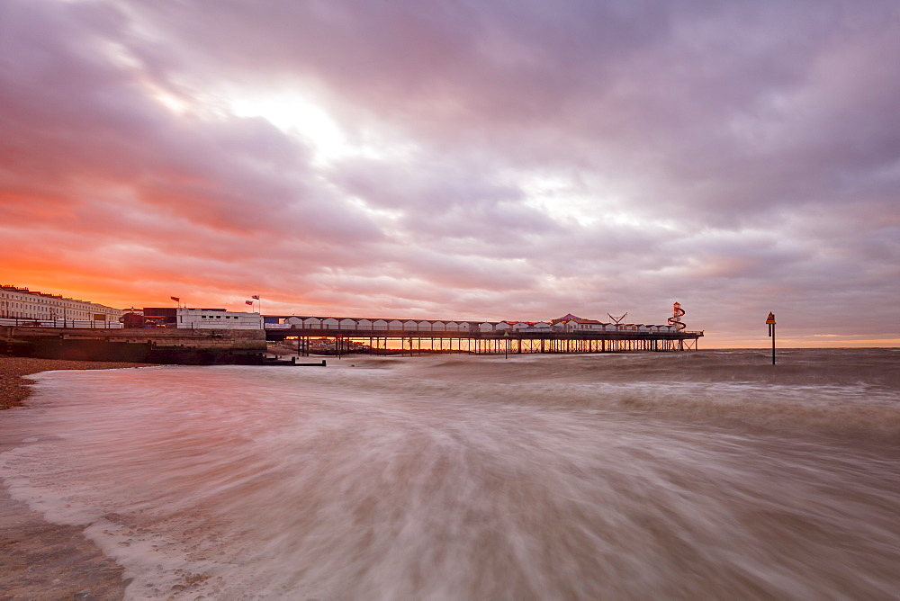 Dramatic skies over Herne Bay Pier at dusk, Herne Bay, Kent, England, United Kingdom, Europe