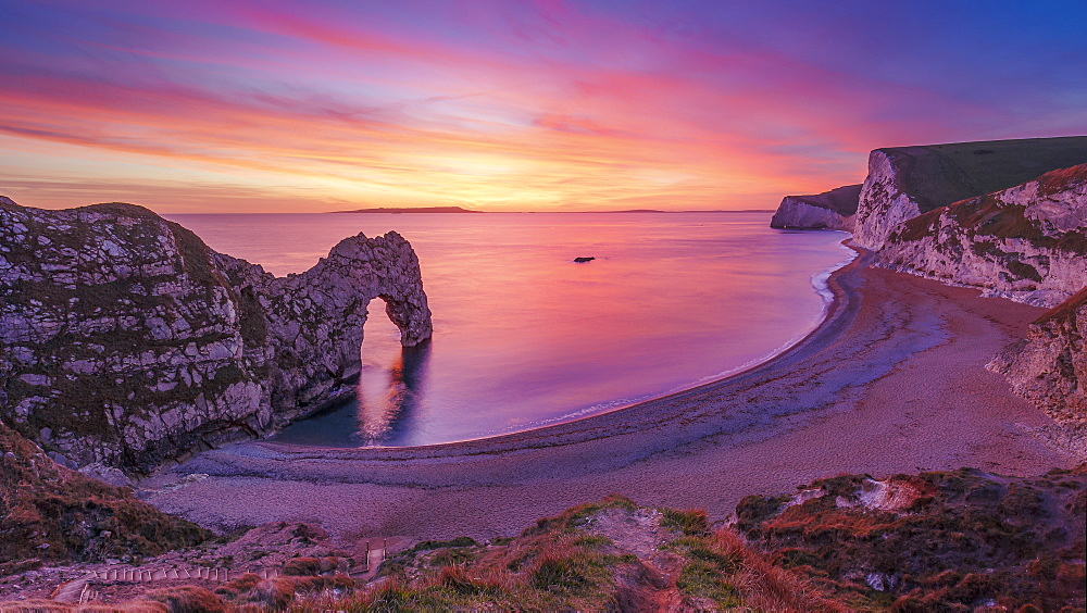 A stunning sunset over Durdle Door on the Jurassic Coast, UNESCO World Heritage Site, Dorset, England, United Kingdom, Europe - 1213-95