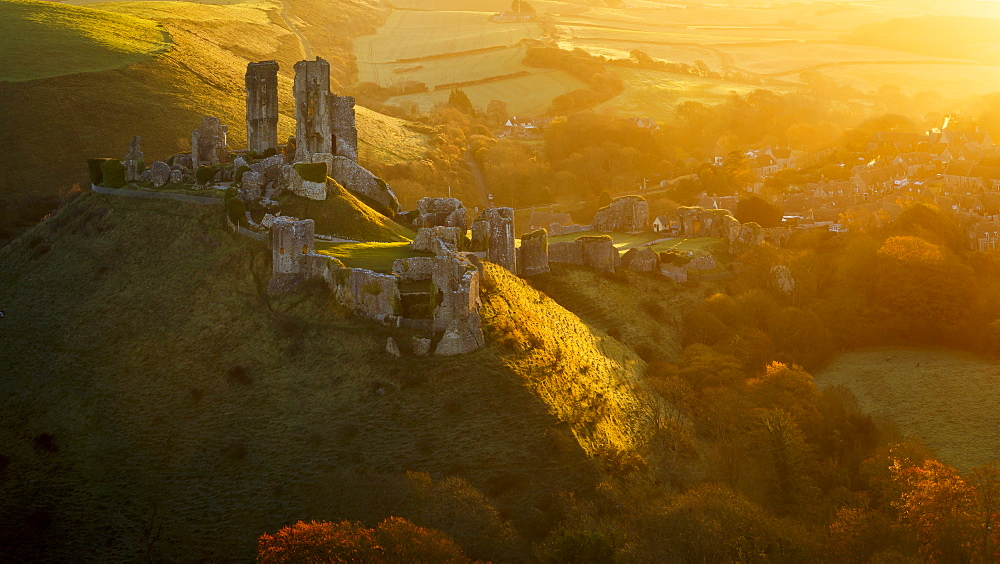 Golden sunrise over the village and castle at Corfe, Dorset, England, United Kingdom, Europe