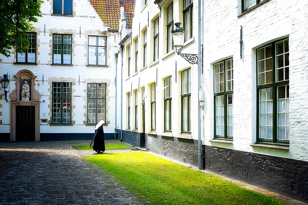 Nun at Begijnhof (Beguinage), Order of St. Benedict convent, Bruges, Belgium, Europe