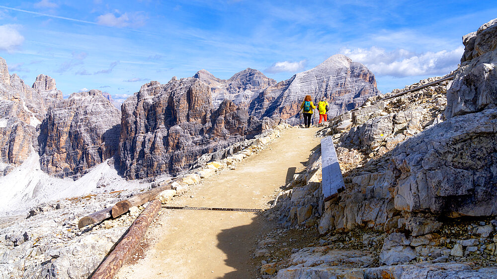 Hikers walking in Monte Lagazuoi, Dolomite mountains, Dolomites, Italy, Europe