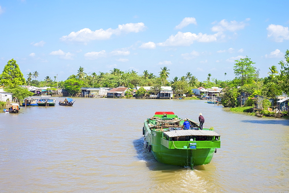 A boat on a branch of the Mekong River at Phong Dien, Can Tho, Mekong Delta, Vietnam, Indochina, Southeast Asia, Asia