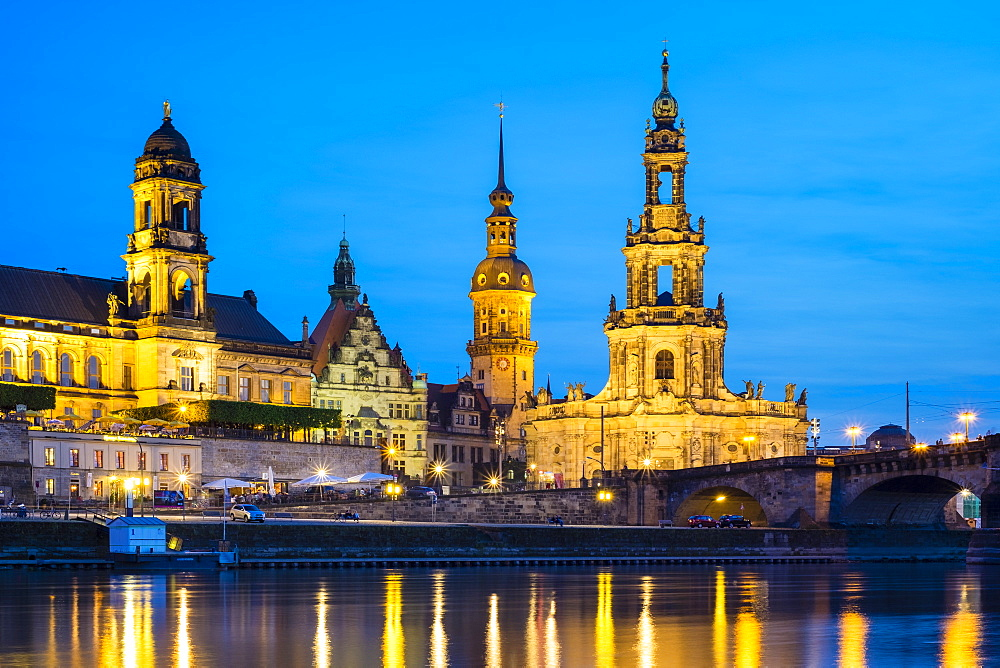 Germany, Saxony, Dresden, Altstadt (Old Town). Dresden skyline, historic buildings along the Elbe River at night.