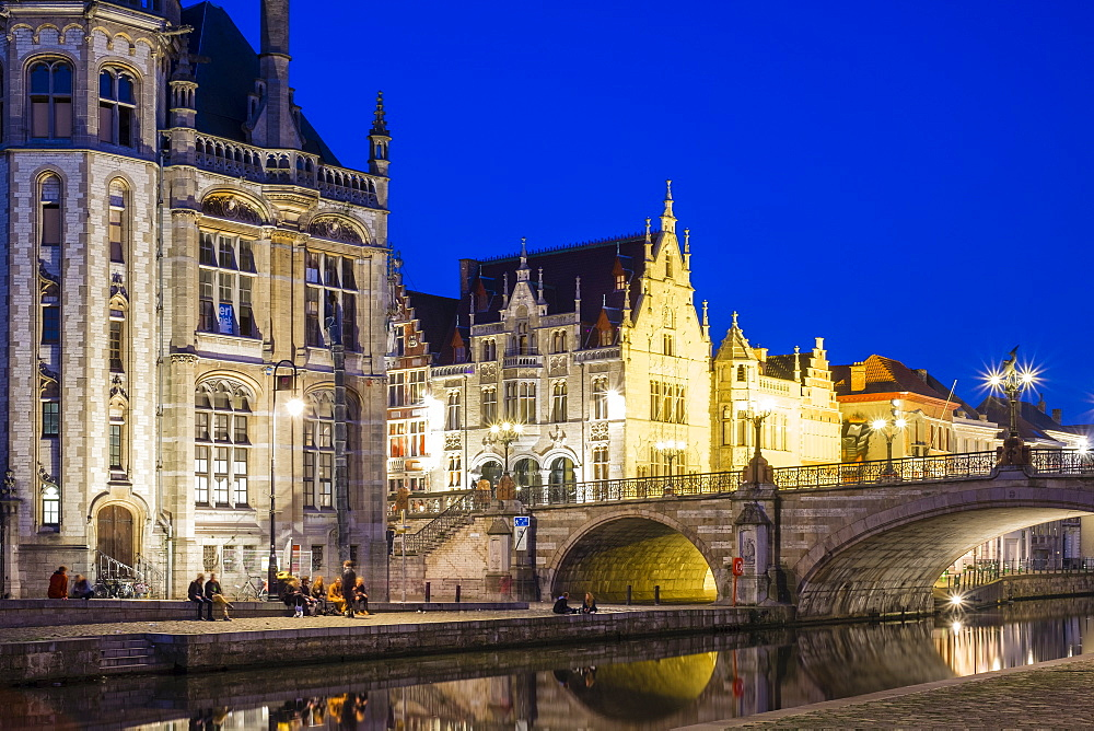 Michielsbrug (St. Michael's Bridge), and buildings on the Leie River at dusk, Ghent, Flanders, Belgium, Europe