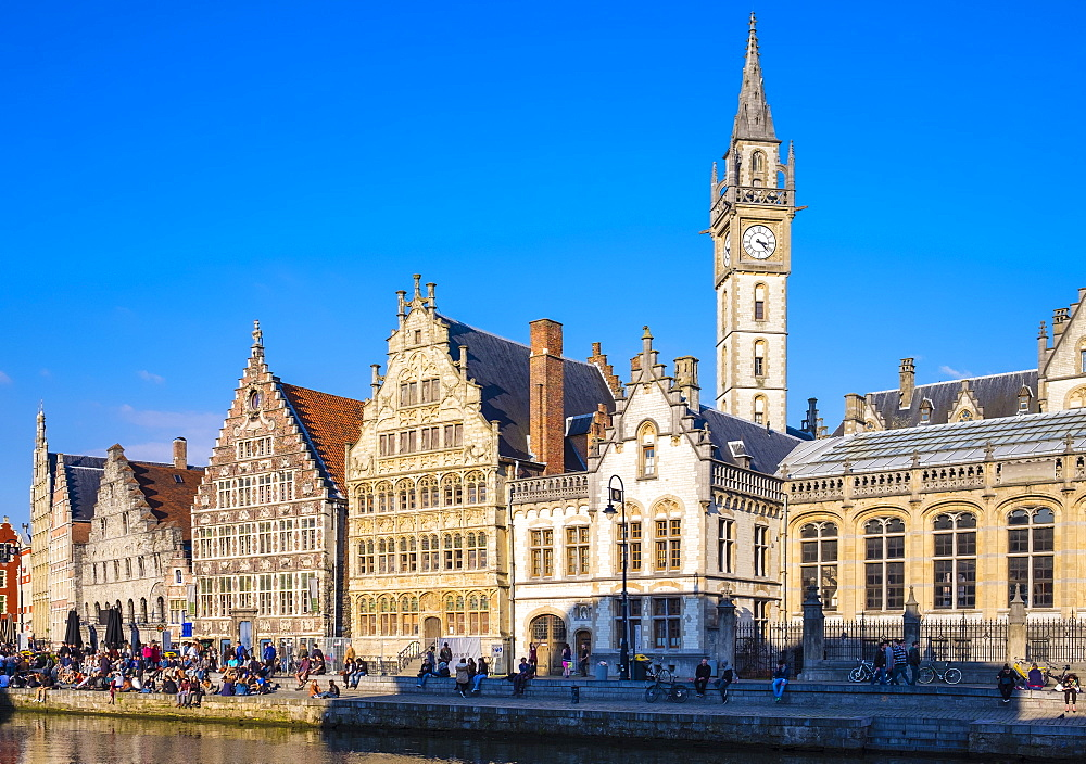 Clocktower of Former Post Office and medieval guild houses on Graslei and the Leie River, Ghent, Flanders, Belgium, Europe