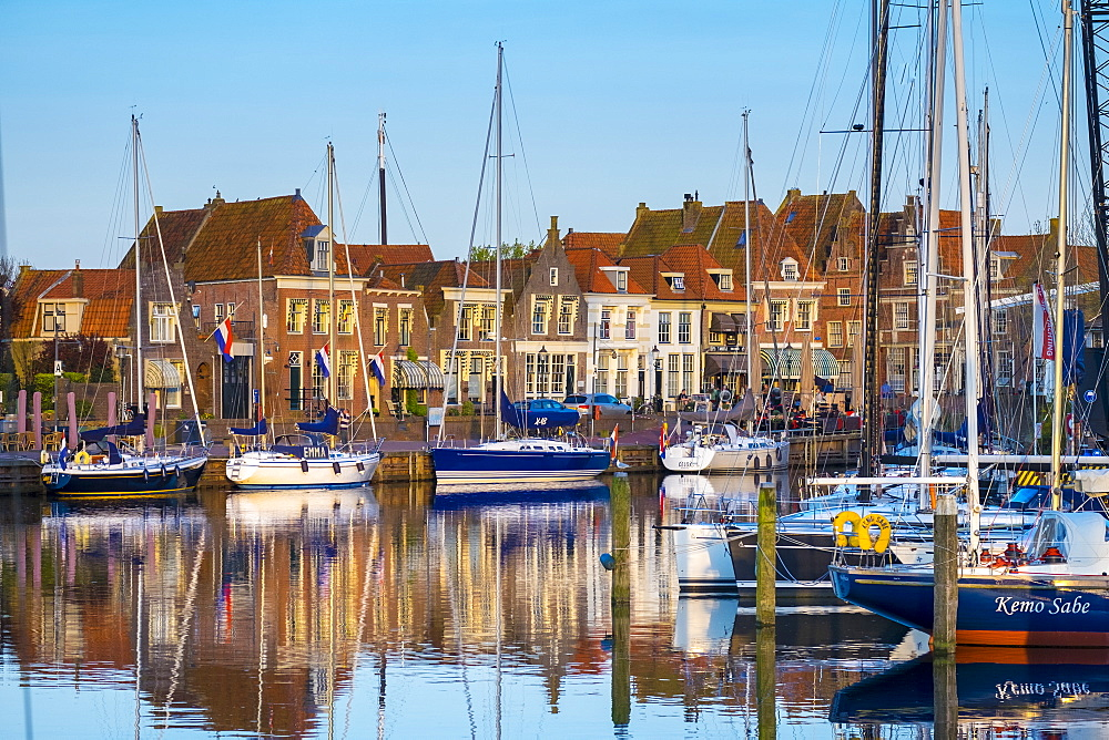 Boats moored in front of historic buildings along the Oude Haven (Old Harbor), Enkhuizen, North Holland, Netherlands, Europe - 1217-294