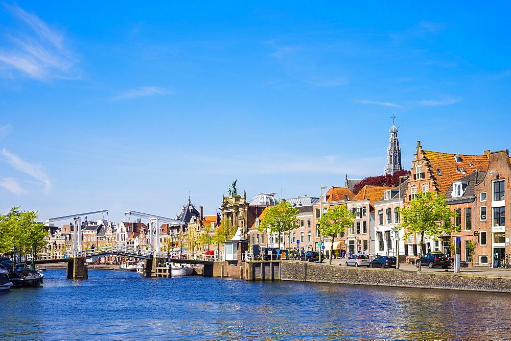 Buildings along the Spaarne River with Gravestenenbrug drawbridge, Haarlem, North Holland, Netherlands, Europe - 1217-312