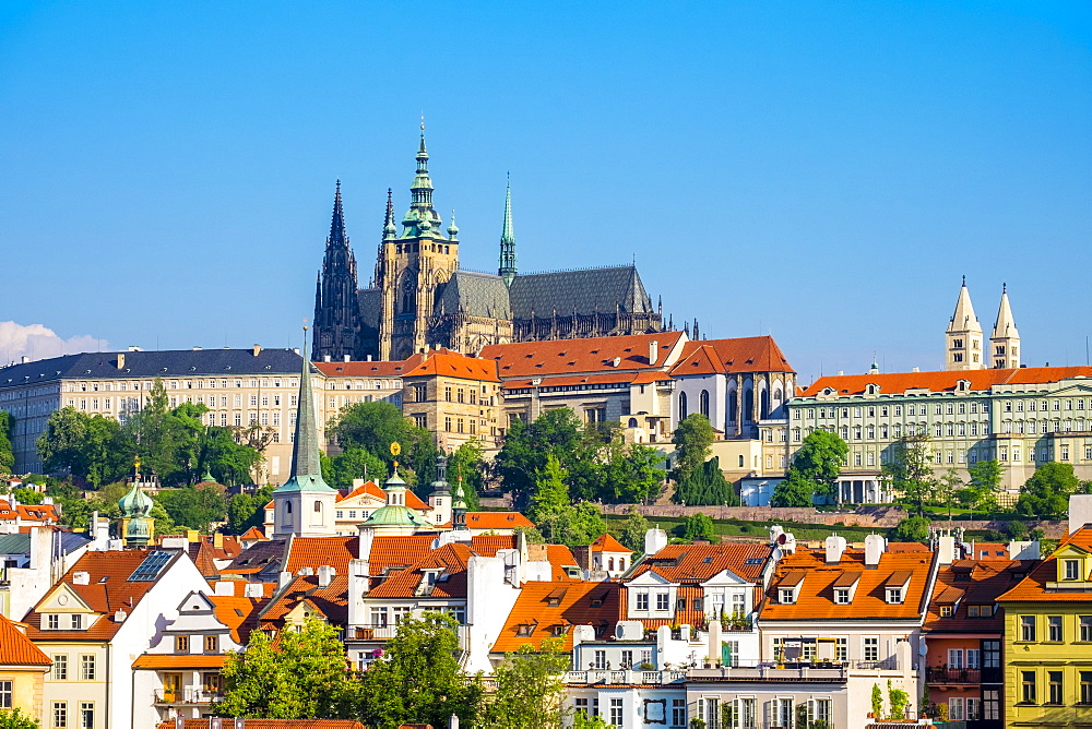View of Prague Castle (Prazsky hrad) on the Vltava River and buildings in Mala Strana, Prague, UNESCO World Heritage Site, Czech Republic, Europe