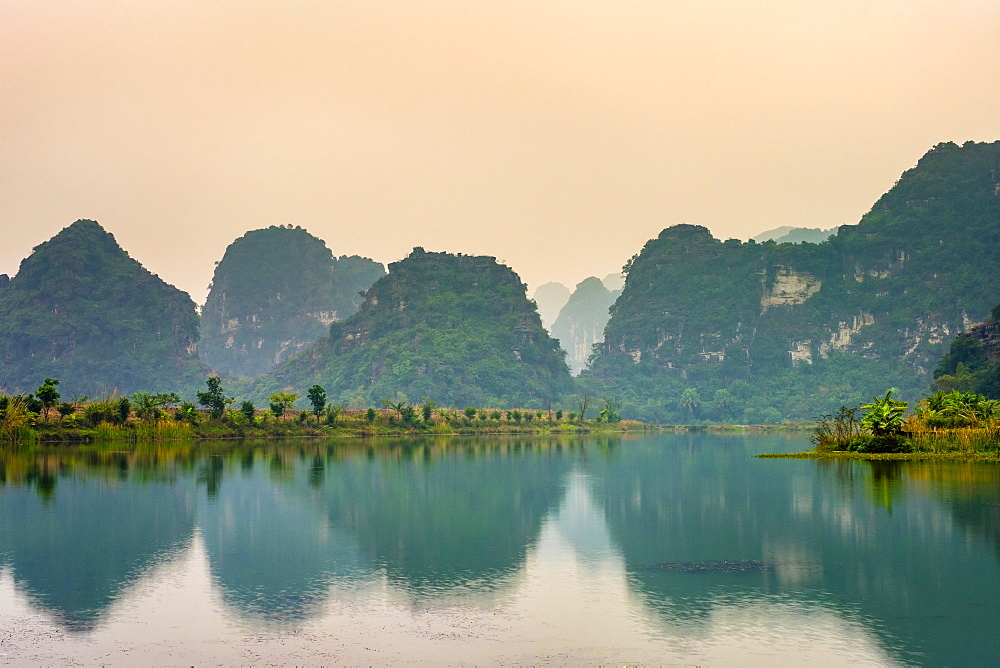 Karst mountain landscape at sunset, Ninh Xuan, Hoa Lu District, Ninh Binh Province, Vietnam, Indochina, Southeast Asia, Asia