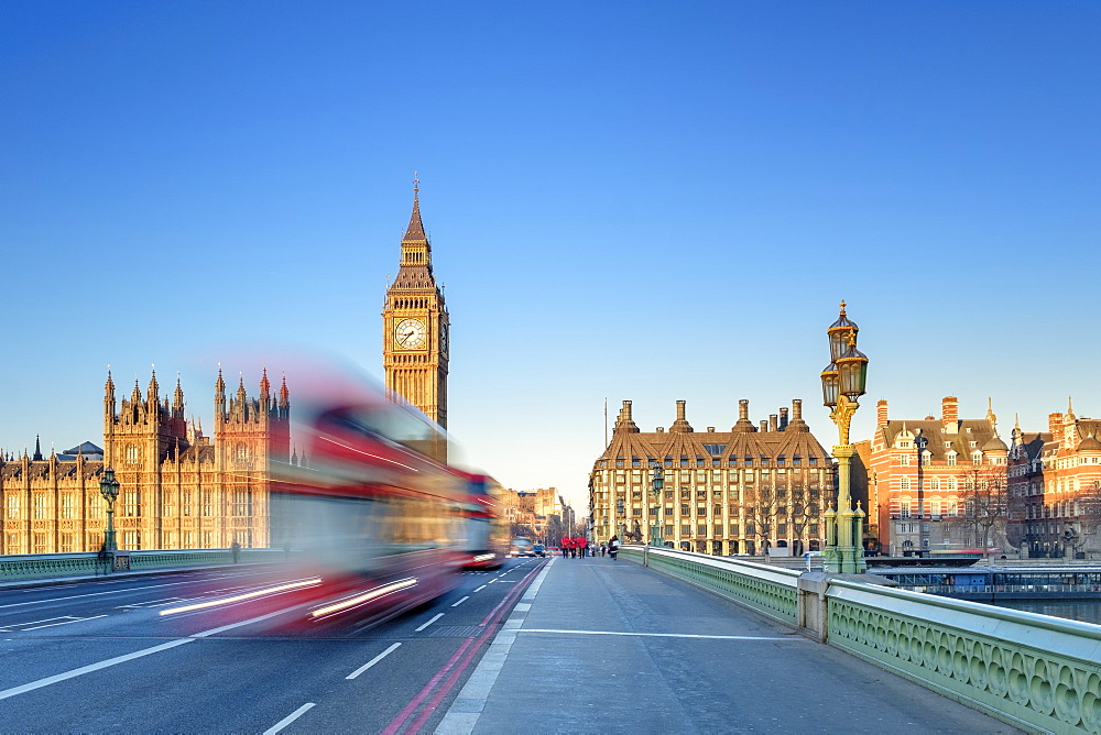Red double-decker bus on Westminster Bridge, in front of the Palace of Westminster, London, England, United Kingdom, Europe