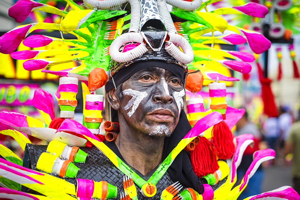 A participant in the Ati-atihan parade wearing a colorful hand-made costume, Kalibo, Aklan, Western Visayas, Philippines, Southeast Asia, Asia - 1217-363