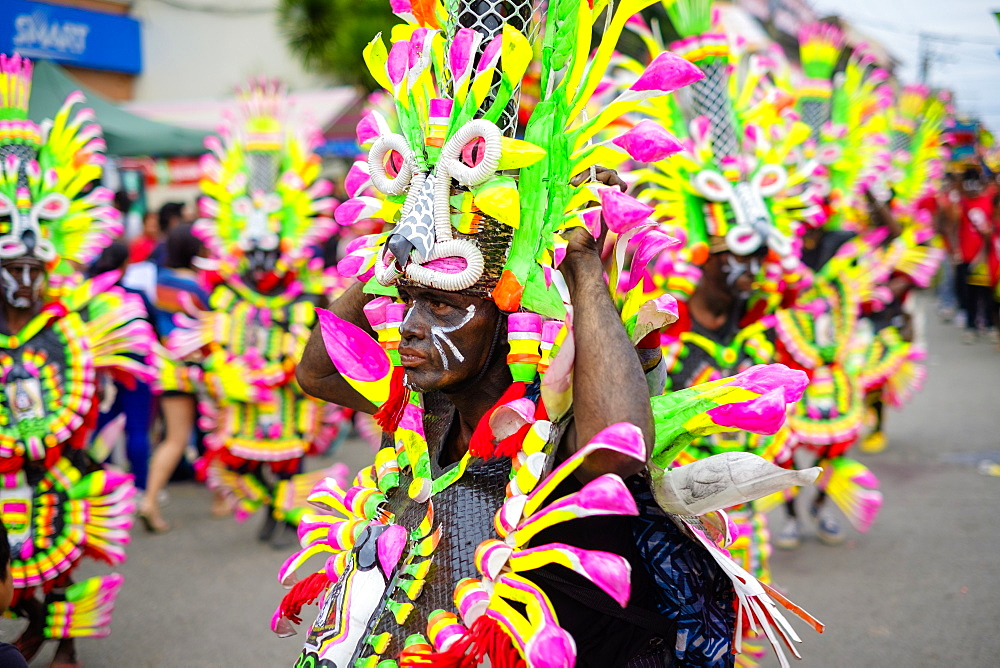 A participant in the Ati-atihan parade wearing a colorful hand-made costume, Kalibo, Aklan, Western Visayas, Philippines, Southeast Asia, Asia - 1217-365