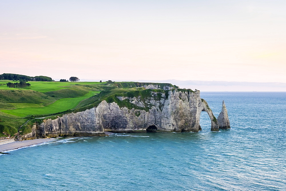 Aiguille d'Etretat, stone arch on the coast of the English Channel at sunset, Etretat, Seine-Maritime, Normandy, France, Europe
