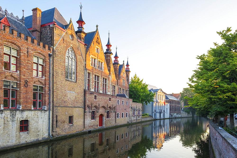 Brugse Vrije and buildings along the Groenerei canal at dusk, Bruges (Brugge), West Flanders (Vlaanderen), Belgium, Europe - 1217-427