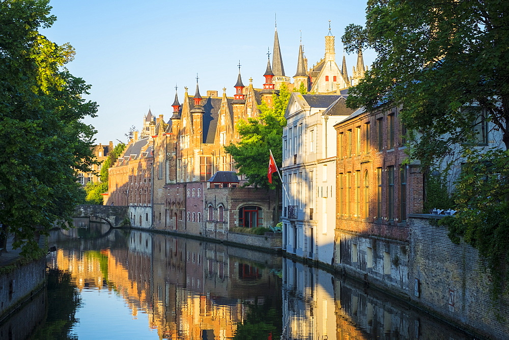 Belgium, West Flanders (Vlaanderen), Bruges (Brugge). Brugse Vrije and buildings along the Groenerei canal at dawn.
