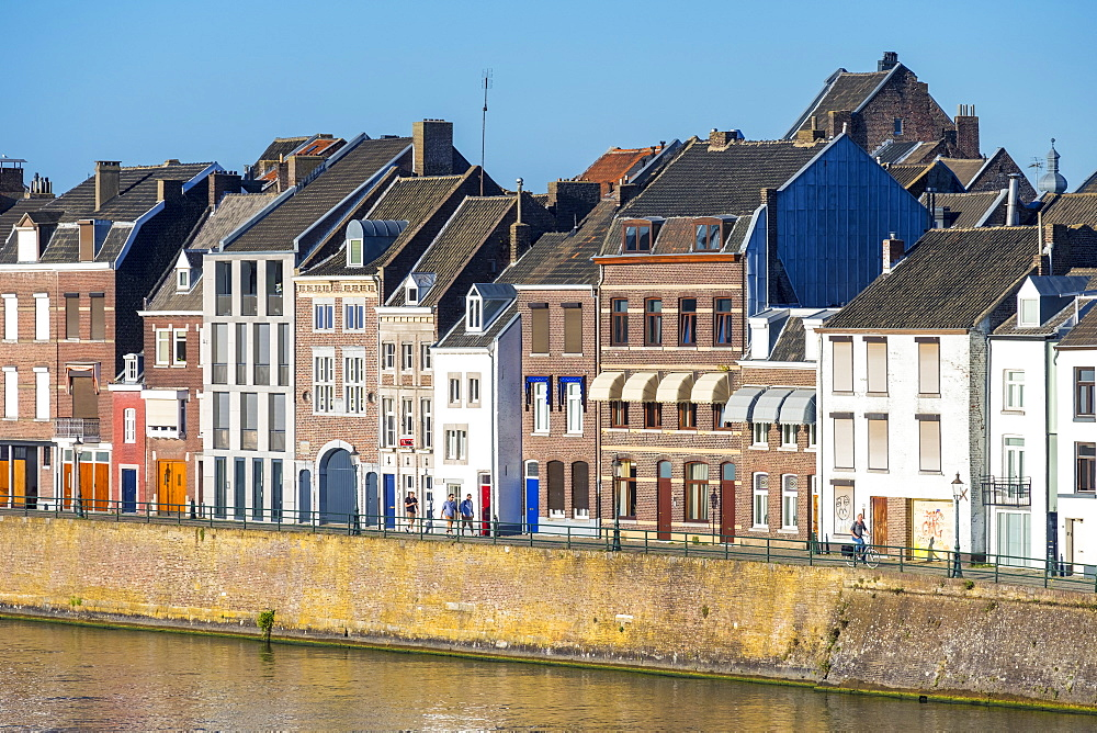 Netherlands, Limburg, Maastricht. Buildings along the Meuse (Maas) River in the Wyck-Ceramique quarter.