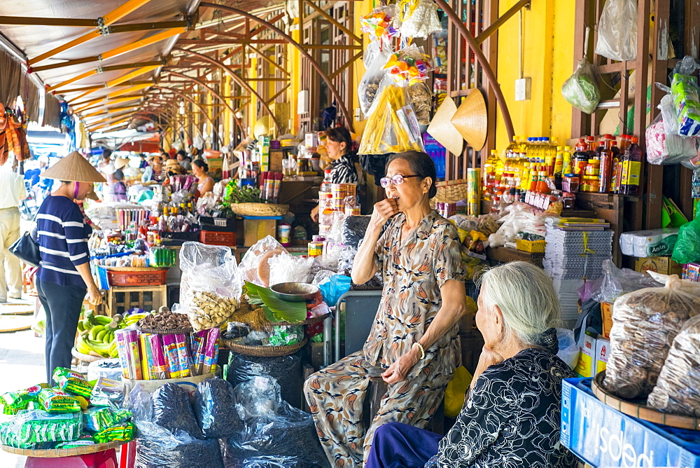 Women selling food items at the central market in Hoi An, Quang Nam Province, Vietnam, Indochina, Southeast Asia, Asia