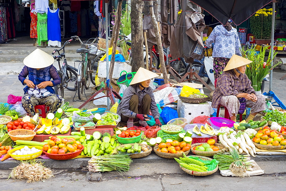 Women selling vegetables at the central market in Hoi An, Quang Nam Province, Vietnam, Indochina, Southeast Asia, Asia