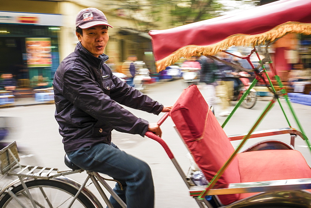 Man driving a Cyclo in Hanoi Old Quarter, Hoan Kiem District, Hanoi, Vietnam, Indochina, Southeast Asia, Asia