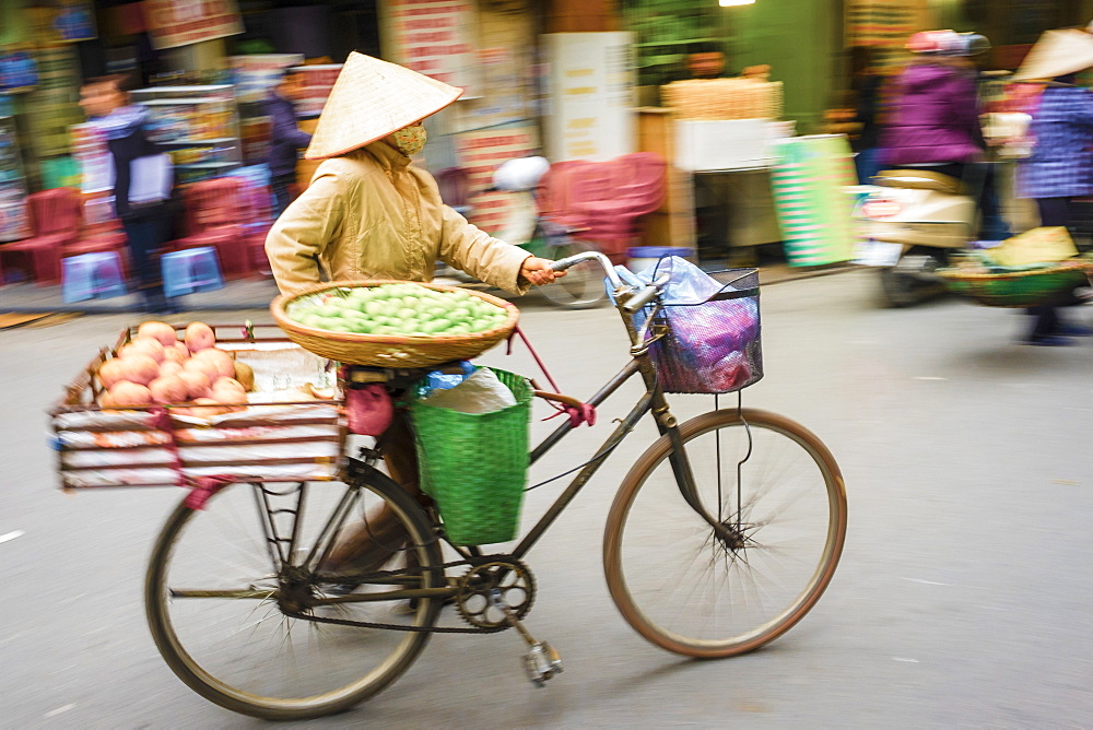 Woman pushing a bicycle in Old Quarter, Hoan Kiem District, Hanoi, Vietnam, Indochina, Southeast Asia, Asia