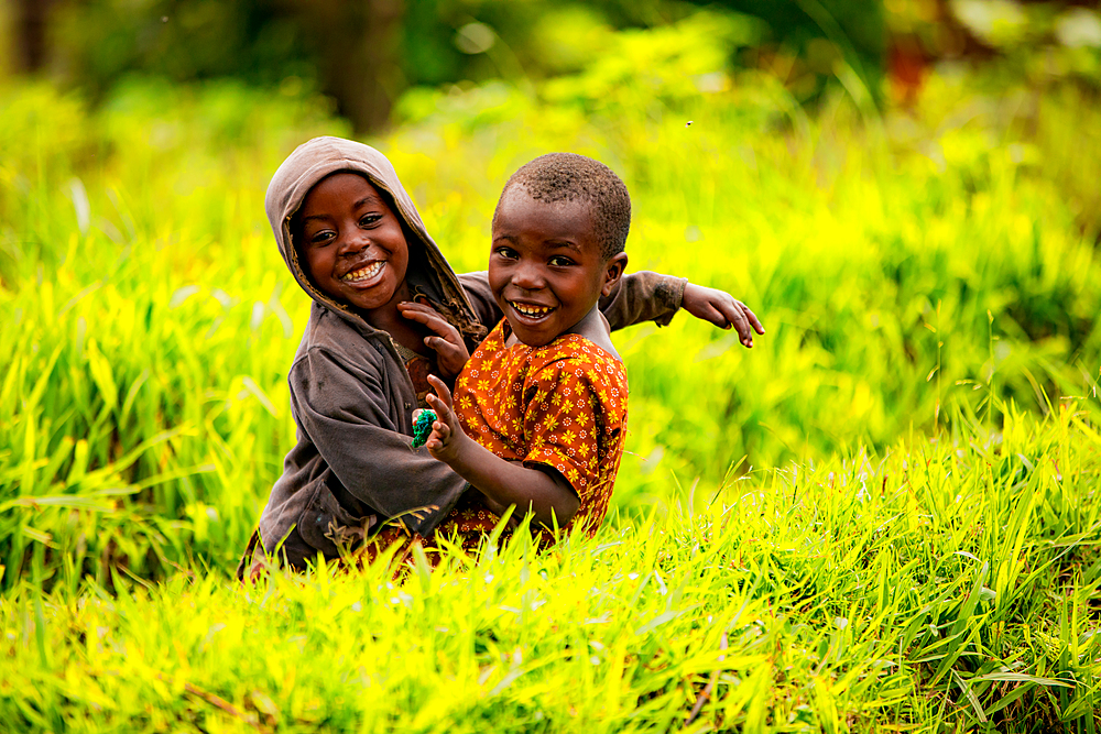 Cute kids posing in Lake Bunyonyi, Uganda, East Africa, Africa