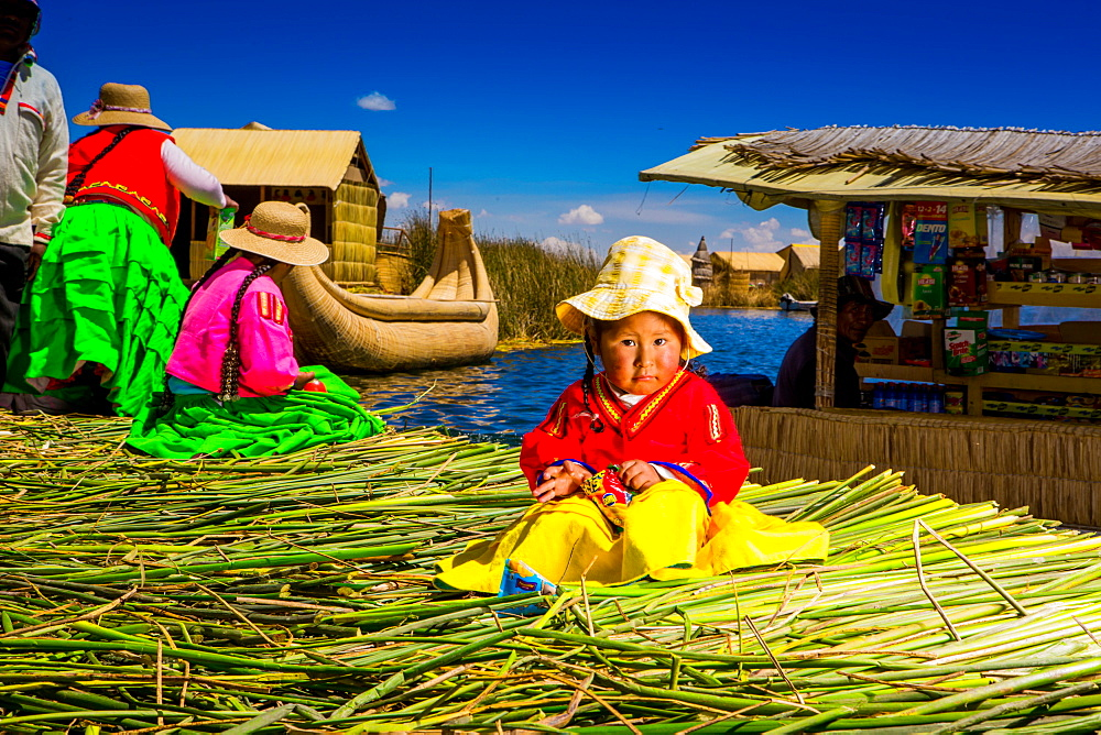 Little Quechua girl on Floating Grass islands of Uros, Lake Titicaca, Peru, South America