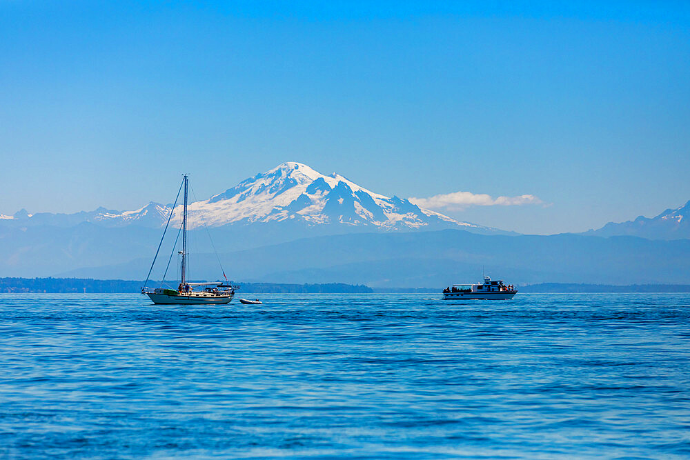 Whale watching boats off the coast of Orcas Island overlooking Mount Baker, Washington State, United States of America, North America