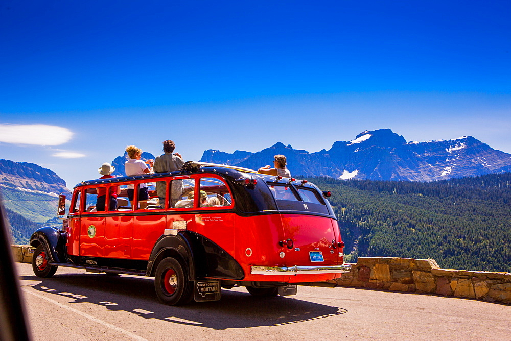 Vintage tour bus on the Sun Road, Glacier National Park, Montana, United States of America, North America