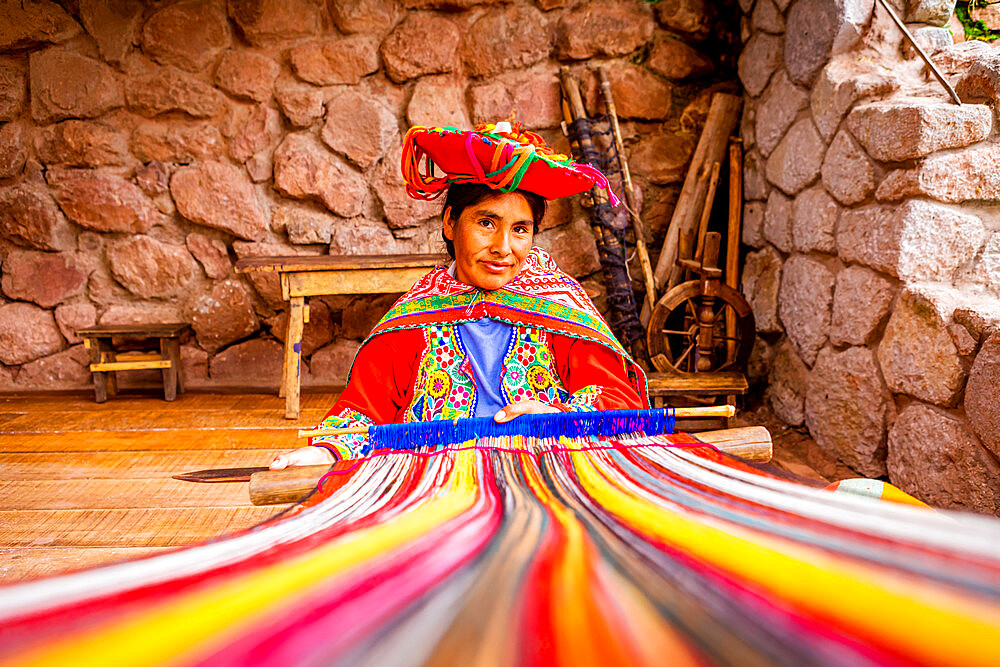 Portrait of Parobamba Quechua woman and loom, Sacred Valley, Peru, South America