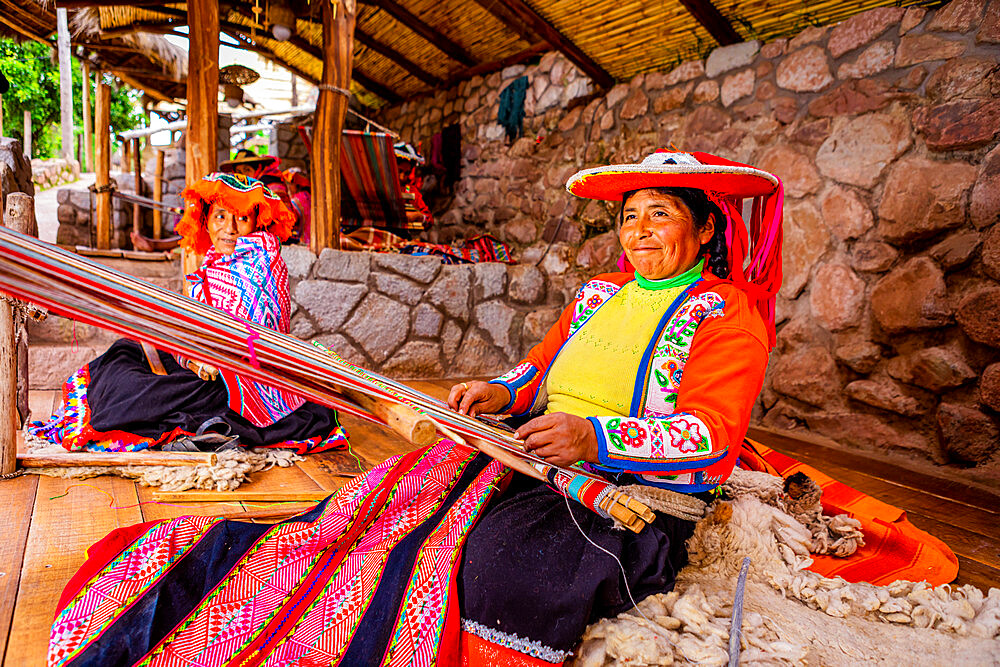 Portrait of Q'eros Quechua woman and loom, Sacred Valley, Peru, South America
