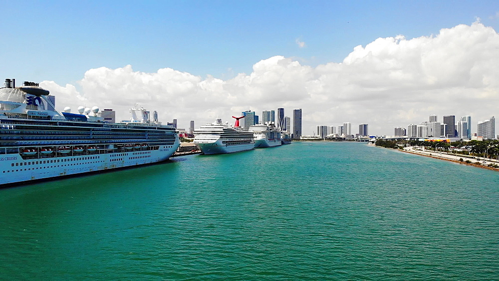 View of Port Miami with cruise ships docked during COVID-19 Pandemic and Coral Princess with sick passengers just allowed to dock, Miami, Florida, United States of America, North America