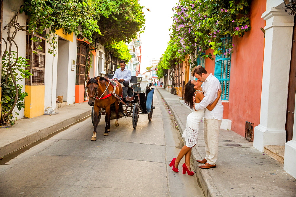 Couple posing in the street, Old Walled-in City, Cartagena, Colombia, South America - 1218-235