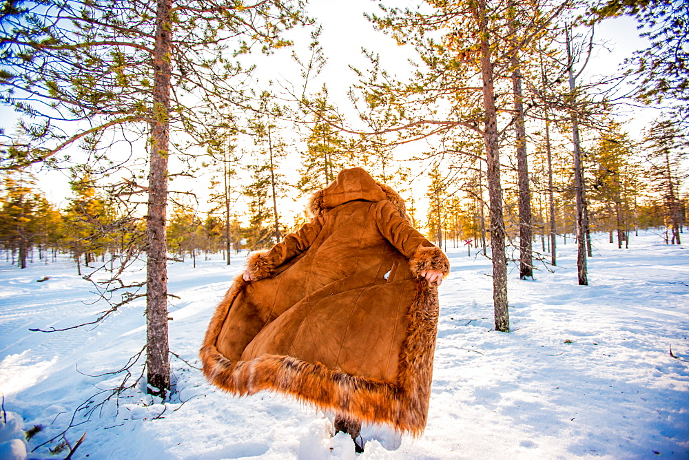 Woman in fur coat in the Arctic Wilderness, Kakslauttanen Igloo West Village, Saariselka, Finland, Scandinavia, Europe