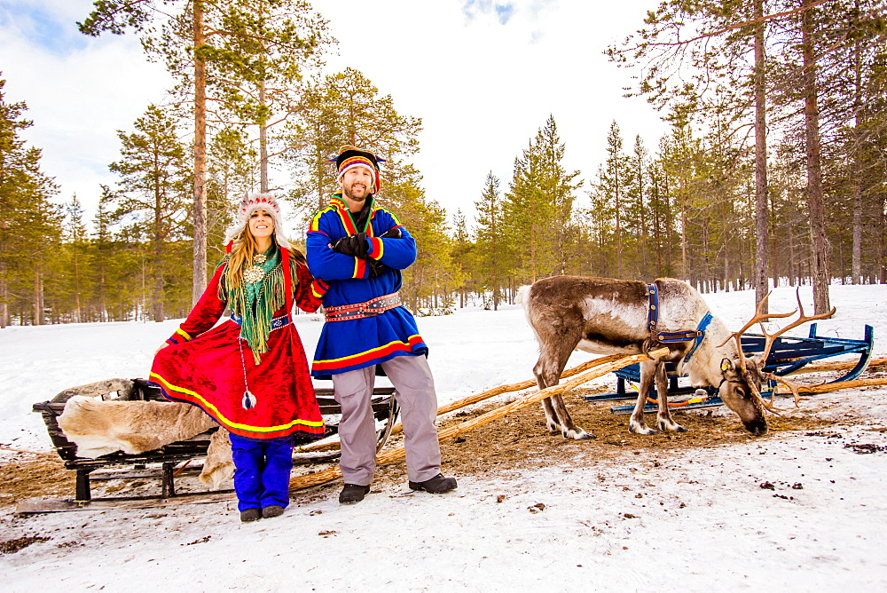 Couple wearing Traditional Sami costumes, Reindeer Safari, Kakslauttanen Igloo Village, Saariselka, Finland, Scandinavia, Europe