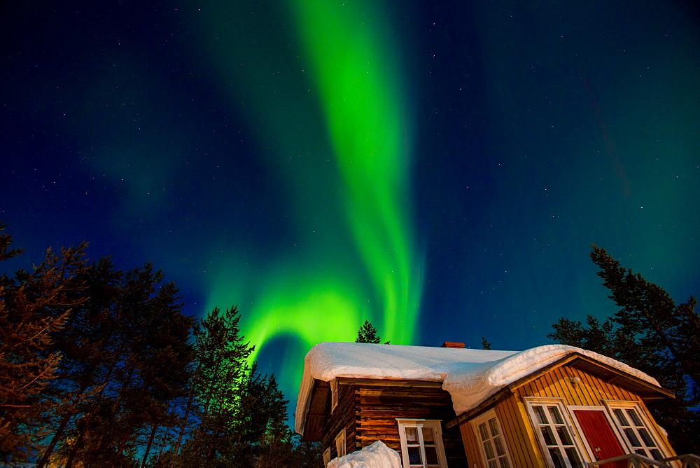 Aurora Borealis (the Northern Lights) over Kakslauttanen Igloo West Village, Saariselka, Finland, Scandinavia, Europe