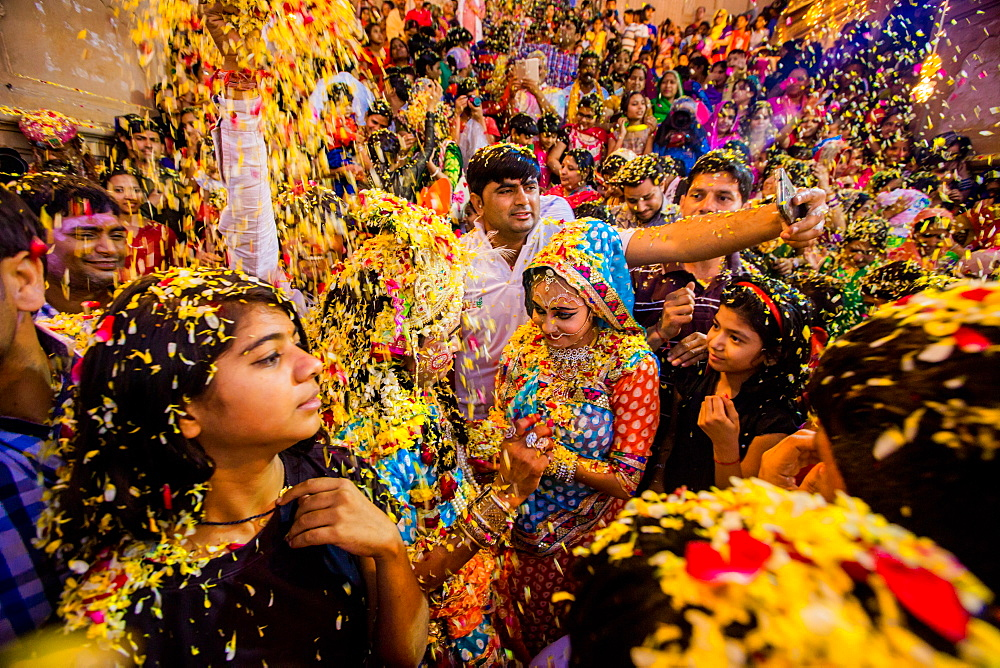 Crowd throwing flower petals during the Flower Holi Festival, Vrindavan, Uttar Pradesh, India, Asia - 1218-311